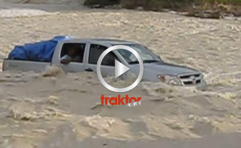 Bil tar sig över flod!