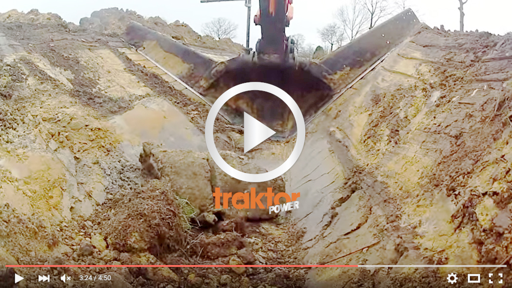 Hitachigrävaren jobbar med en stor skön skopa.