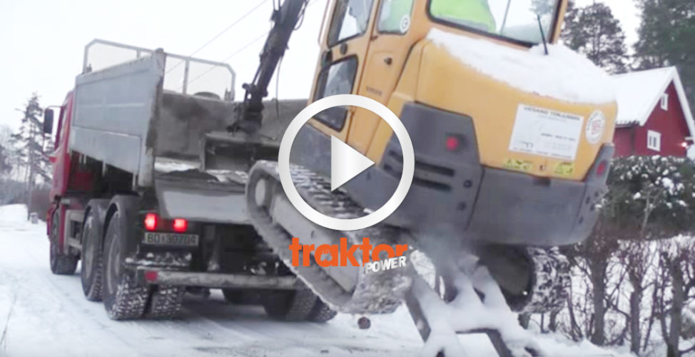 Volvogrävare klättrar upp på flaket!!!