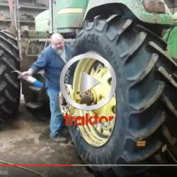 Se hur den här killen monterar däcken på traktorn!